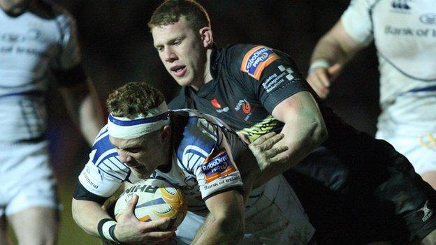 Ian Madigan of Leinster is tackled