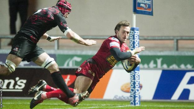 Andy Fenby goes over for the Scarlets