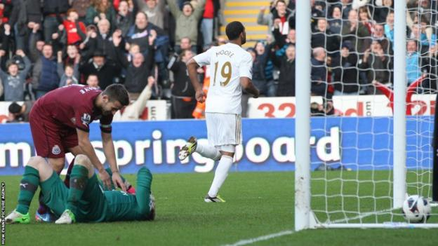 Luke Moore celebrates his winner for Swansea against Newcastle.