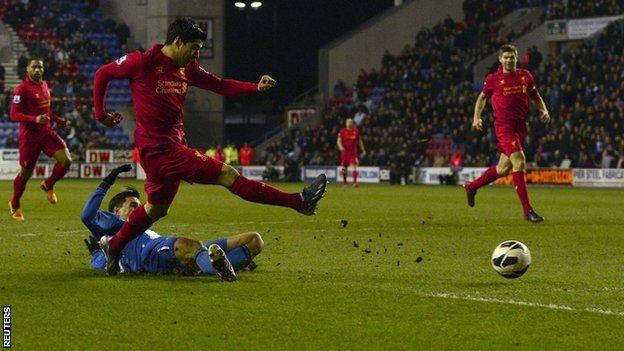 Luis Suarez scores his third for Liverpool