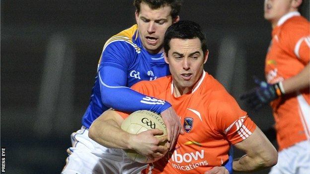 Aidan Rowan tackles Aaron Kernan at the Athletic Grounds