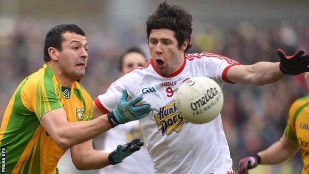 Tyrone's Sean Cavanagh attempts to block a Frank McGlynn handpass at Healy Park