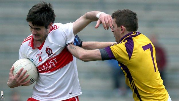 Derry's Chrissy McKaigue tries to hold off Wexford's Adrian Flynn