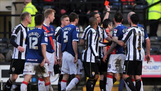 Carlisle striker Lee Miller sent off