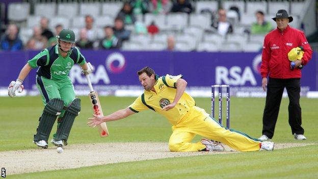 Australian bowler Ben Hilfenhaus dives for the ball against Ireland at Stormont last year