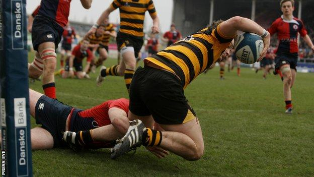 Iain Jones goes over for a RBAI try against Ballyclare