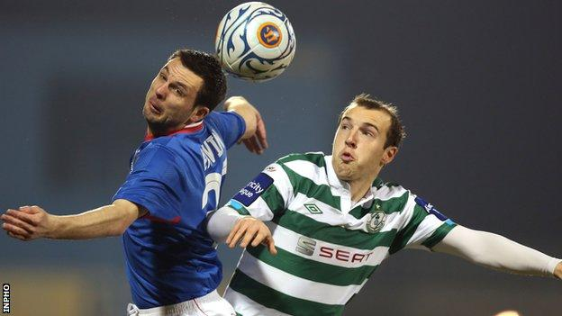 Linfield's Jim Ervin beats Karl Sheppard to the high ball