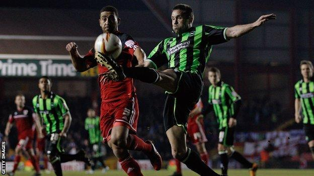 Matthew Upson clears for Brighton at Bristol City