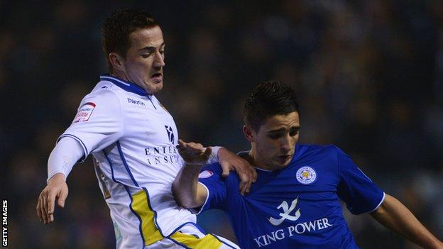 Ross McCormack of Leeds United battles with Anthony Knockaert of Leicester City