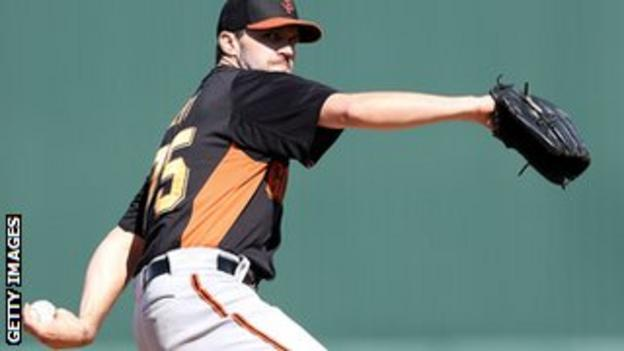 Relief pitcher Barry Zito of the San Francisco Giants pitches against the Los Angeles Angels