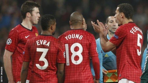 Rio Ferdinand claps referee