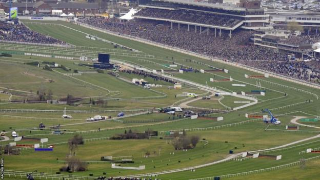 Crowds pack the stands in the background of this panoramic view of Cheltenham racecourse