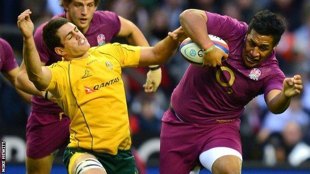 Mako Vunipola blasts past the attempted tackle of Australia's Ben Alexander