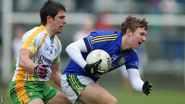 Kerry's James O'Donoghue with Paddy McGrath of Donegal