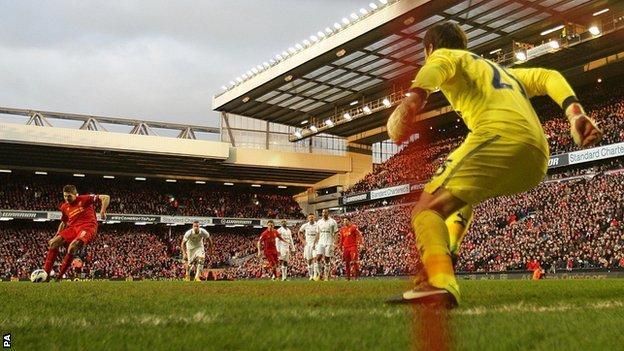 Liverpool captain Steven gerrard (left) scores his side's winner against Tottenham from the penalty spot