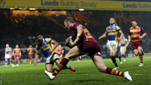Aaron Murphy scores a try for Huddersfield against Leeds Rhinos