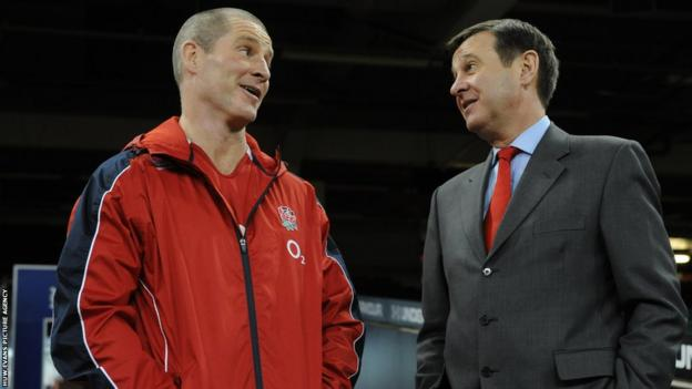 England head coach Stuart Lancaster chats with Welsh Rugby Union chief executive Roger Lewis prior to a training session at the Millennium Stadium.