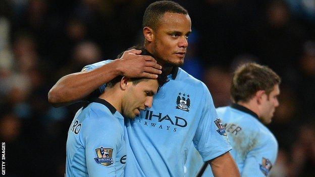 Manchester City's Sergio Aguero and Vincent Kompany