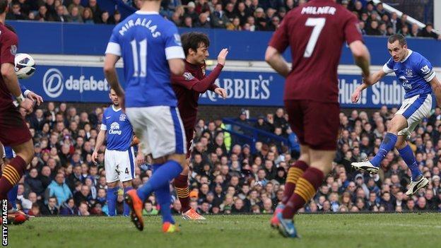 Leon Osman (far right) puts Everton ahead in the first half
