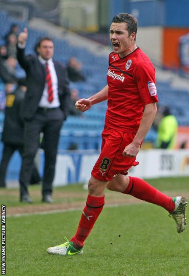 Don Cowie celebrates after giving Cardiff the lead against Sheffield Wednesday and earning the approval of his manager Malky Mackay.