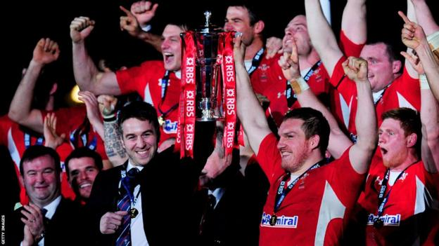 Wales captains Ryan Jones and Gethin Jenkins lift the Six Nations trophy after beating England 30-3 at the Millennium Stadium - a record win in Cardiff