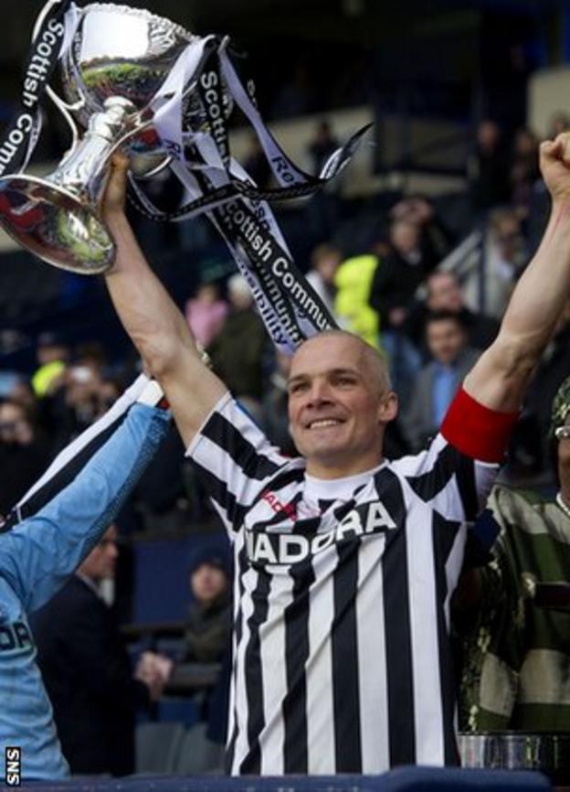 St Mirren skipper Jim Goodwin lifts the League Cup