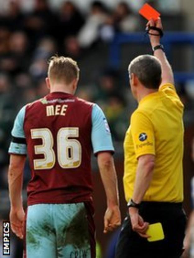 Ben Mee is shown a red card by referee Andy D'Urso