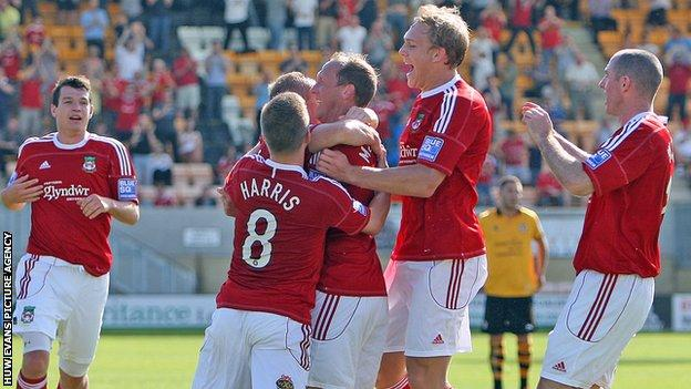 Wrexham players celebrate a goal