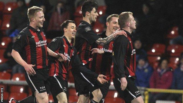 Crusaders players congratulate Jordan Owens after his opener against Linfield