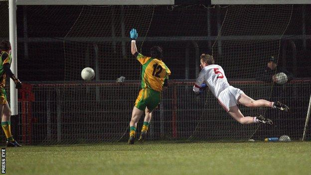Tyrone's Stefan Tierney (right) scores a goal against Donegal