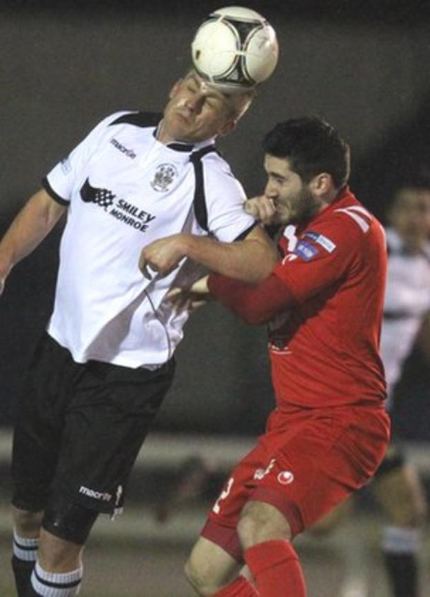 Distillery's Aaron Boyd gets above Portadown midfielder Sean Mackle