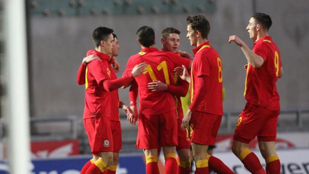 Wales Under-21 players celebrate a goal against Moldova