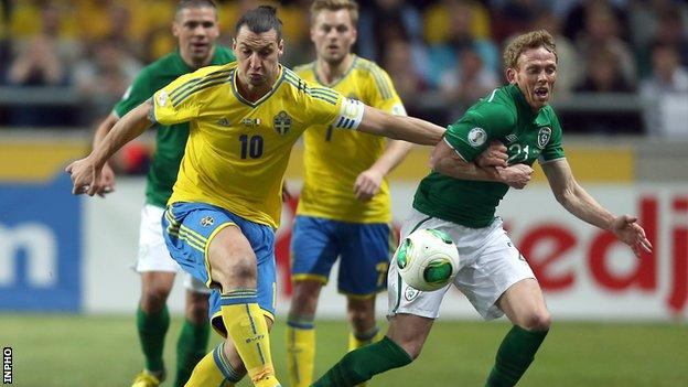 Zlatan Ibrahimovic battles with Paul Green in Stockholm
