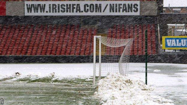 Snow was cleared from the Windsor Park pitch on Friday