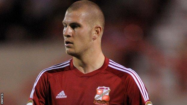 Swindon's James Collins was denied by the Notts County keeper