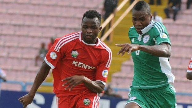 Kenya forward Johanna Ochieng (left) vies for the ball with Nigeria defender Ideye Brown