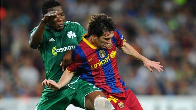 Simao Mate (left) in action for Panathinaikos against Lionel Messi of Barcelona
