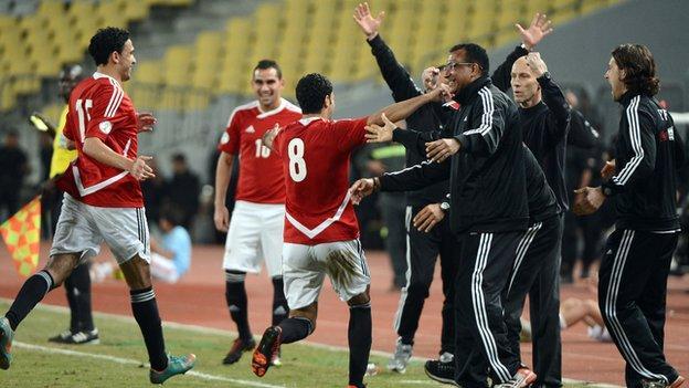 Egypt celebrate scoring against Zimbabwe