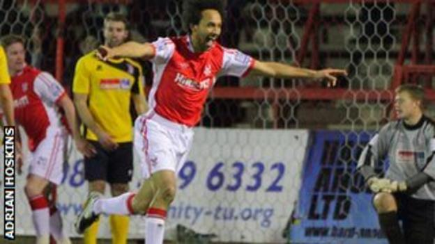 Josh Gowling puts the Harriers ahead at Aggborough against Woking