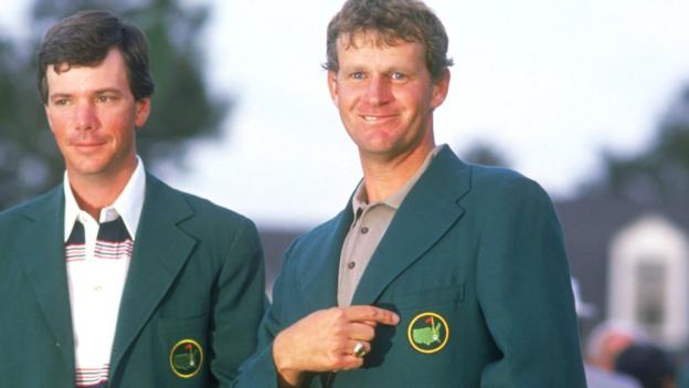 Sandy Lyle celebrates his 1988 Masters win, watched by former champion Larry Mize (left)