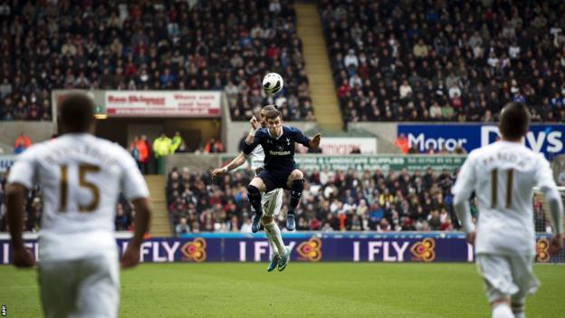 Tottenham Hotspur's Welsh midfielder Gareth Bale jumps for a header against Swansea's Chico Flores
