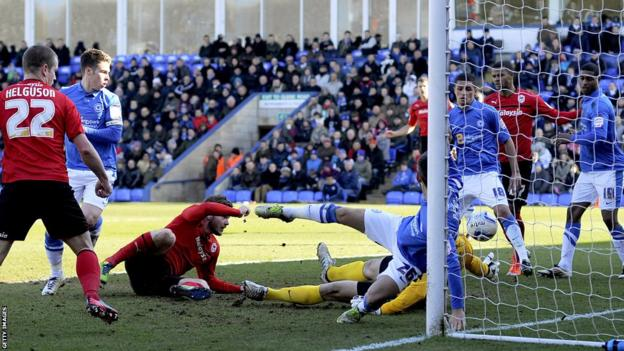 Aron Gunnarsson of Cardiff City scores the first goal of the game during the Championship match at Peterborough United
