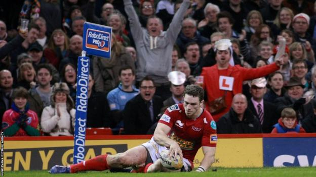George North scores his second try as the Scarlets win 28-20 against the Dragons