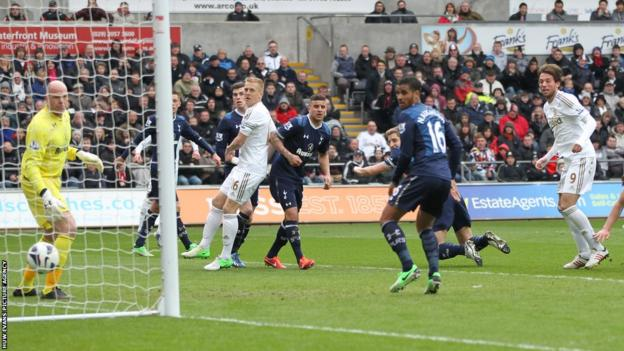Michu gives Swansea hope with a headed goal to peg Spurs back but the visitors hang on for a 2-1 win