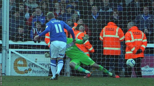 Peterborough substitute Grant McCann scores two late penalties as the home side come from behind to beat Cardiff 2-1