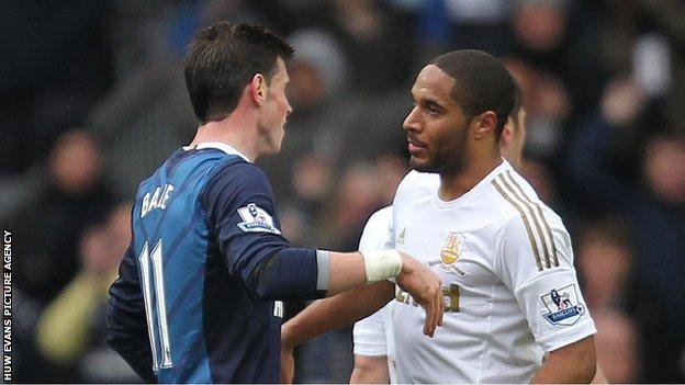 Fellow Wales star Gareth Bale commiserates with Ashley Williams after his Spurs side beat Swansea