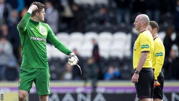 Celtic goalkeeper Fraser Forster exchanges words with referee Bobby Madden