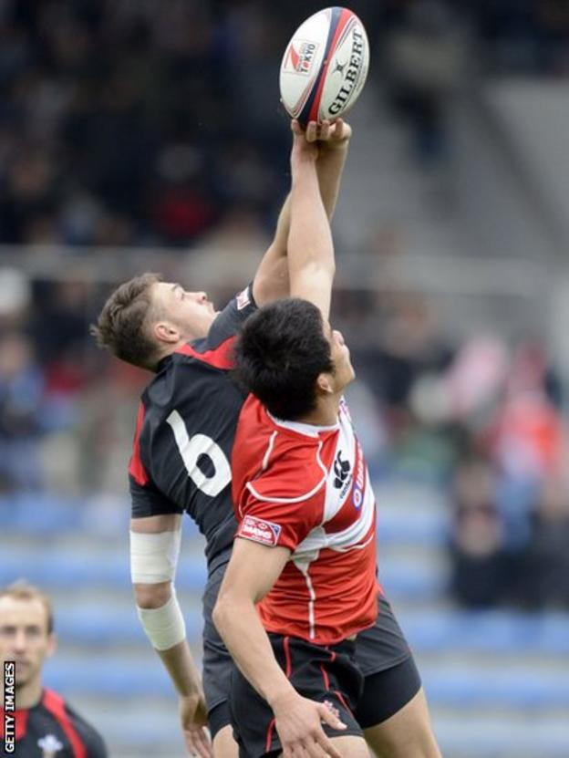 Wales' Cory Allen (left) and Yusaku Kuwazuru of Japan reach for the ball