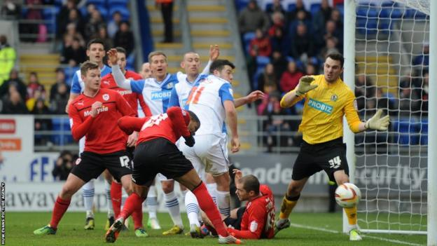 Fraizer Campbell stoops to head Cardiff City into the lead against Blackburn Rovers in their Championship match on Easter Monday