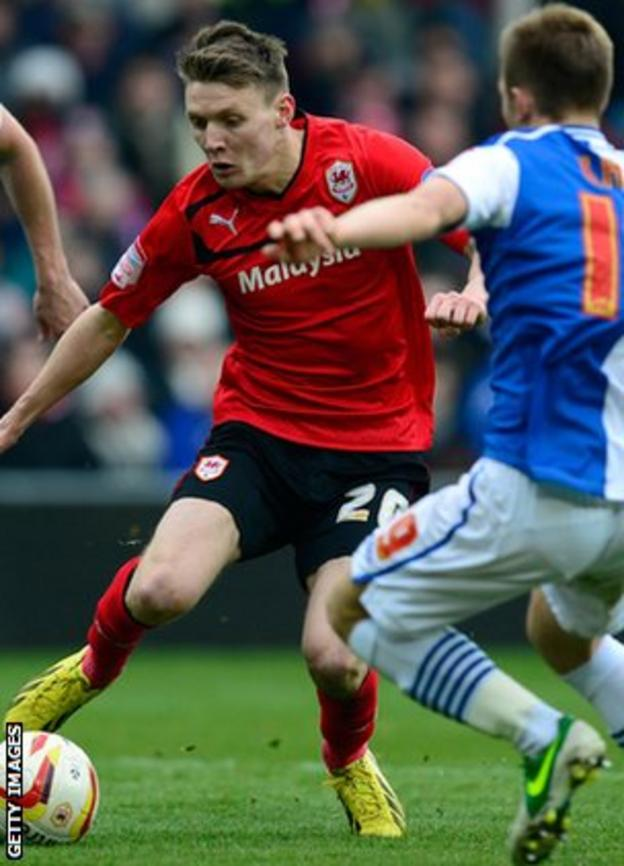 Forward Joe Mason weaves through the Blackburn defence to fire in the second Cardiff goal